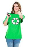Smiling environmental activist holding phone giving thumbs up