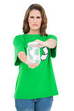 Serious environmental activist holding glass looking at camera