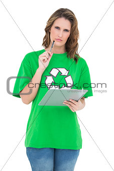 Thoughtful environmental activist holding clipboard