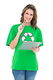Smiling environmental activist holding clipboard looking at camera