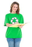 Happy environmental activist holding notebook