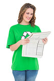 Smiling environmental activist reading newspaper