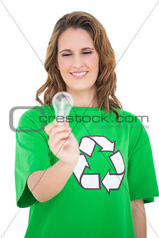 Close up on environmental activist holding light bulb