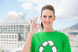 Cheerful environmental activist making okay gesture