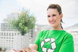 Happy activist holding plant