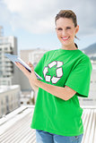 Environmental activist wearing recycling tshirt using tablet