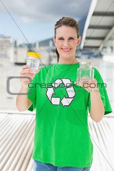 Smiling activist holding glass pots