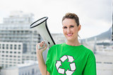 Smiling woman wearing recycling tshirt holding megaphone