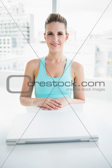 Smiling woman in sportswear posing