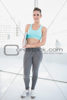 Woman in sportswear holding laptop