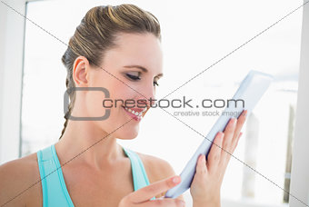 Close up view on smiling woman holding tablet