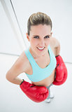Fit woman wearing boxing gloves