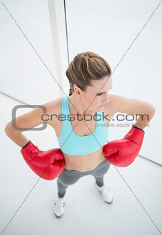 Fit woman with boxing gloves posing