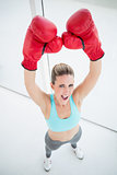 Woman with red boxing gloves arms up
