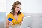 Pretty blonde using her credit card to buy online