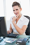 Smiling businesswoman working on computer