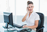 Smiling businesswoman calling with her mobile phone
