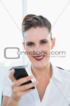 Close up view of businesswoman using smartphone
