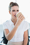 Stylish businesswoman drinking coffee