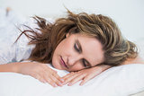 Close up view on woman sleeping in cosy bed