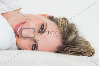 Close up of smiling pretty blonde woman