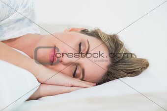 Attractive blonde woman sleeping