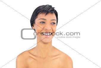 Laughing black haired woman looking away