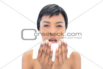 Black haired model about to sneeze