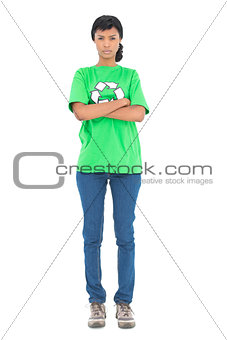 Frowning black haired ecologist posing with crossed arms