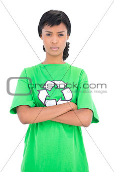 Irritated black haired ecologist posing with crossed arms