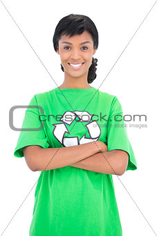 Happy black haired ecologist posing with crossed arms