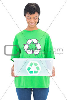 Delighted black haired ecologist holding a recycling box