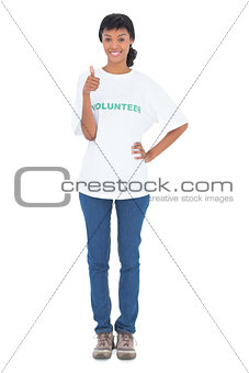 Smiling black haired volunteer giving a thumb up