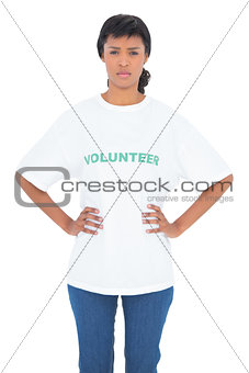 Irritated black haired volunteer posing with hands on the hips