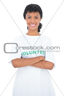 Content black haired volunteer posing with crossed arms