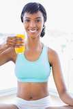Relaxed fit woman enjoying a glass of orange juice