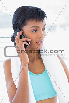 Meditative black haired woman phoning