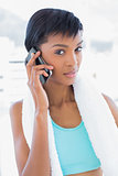 Attractive black haired woman calling someone with her mobile phone