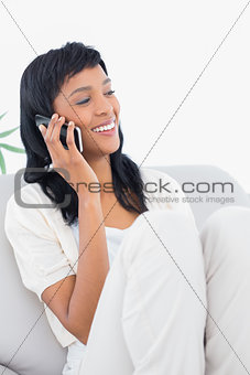 Attractive black haired woman in white clothes phone calling