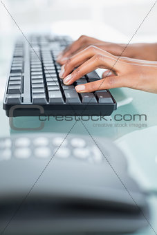 Close up of a businesswoman typing on a keyboard