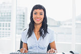 Lovely businesswoman sitting at her desk