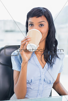 Calm businesswoman drinking coffee