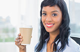 Attractive businesswoman holding coffee