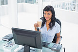Charming businesswoman holding a cup of coffee