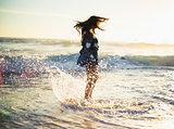 Stylish gorgeous woman enjoying in the sea