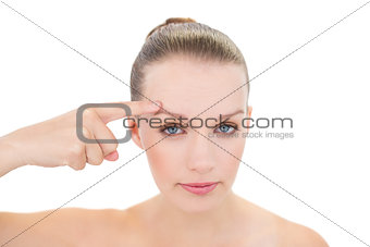 Unsmiling pretty blonde model showing her brow