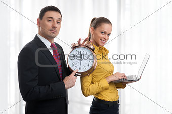 business people with laptop and alarm clock