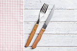 knife and fork on wooden table