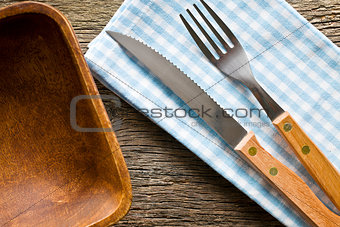 knife and fork on checkered napkin