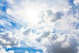Sun in clouds on blue sky